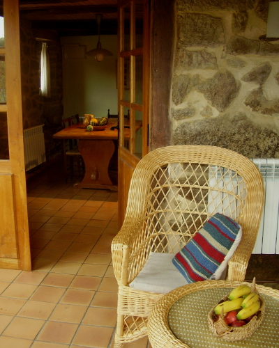 breakfast in Casa dos Artesans´ cool entrance hall with hand-made willow furniture
